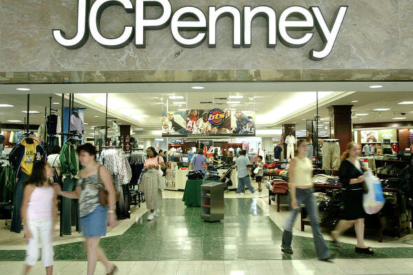 FILE - In this Aug. 16, 2005 file photo, customers walk out of a J.C. Penny department store in Dallas.   J.C. Penney said Friday, Feb. 24, 2017, that it will be closing anywhere from 130 to 140 stores as well as two distribution centers over the next several months as it aims to improve profitability in the era of online shopping.(AP Photo/Matt Slocum)