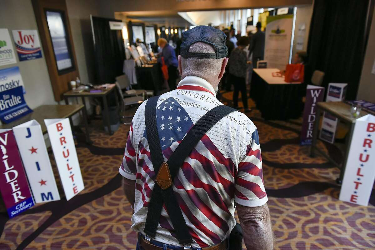Tea Party member Chris Ivey of Paso Robles wears an American flag shirt as he walks down a hallway during the California Republican Party's 2017 Organizing Convention in Sacramento, CA, on Friday February 24, 2017.