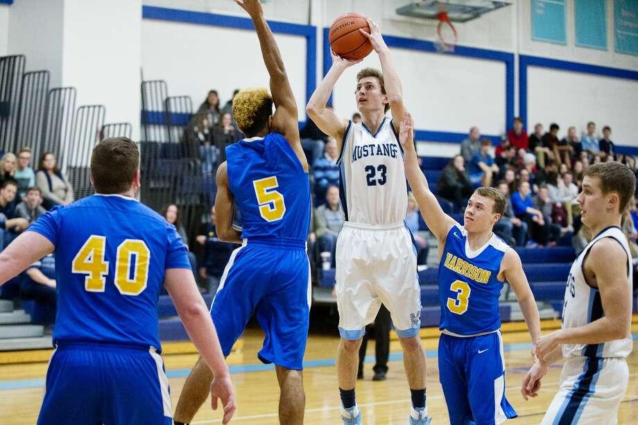 Meridian's Jacob Zielinski shoots the ball on Friday at Meridian High School. Photo: Erin Kirkland/Midland Daily News