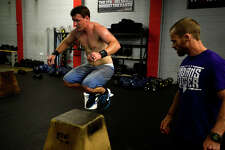 Jeremy Hebert does a box jump during the first week of the Crossfit Open at Crossfit Beaumont on Friday evening. Athletes at Crossfit gyms around the world complete the same workout each weekend for five weeks in friendly competition and the chance to advance to larger competitions.  Photo taken Friday 2/24/17 Ryan Pelham/The Enterprise