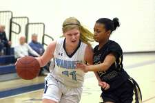 Wilton's Claire Gulbin, left, drives past East Hartford defender Imani Muhammad in the first quarter of Friday's game.