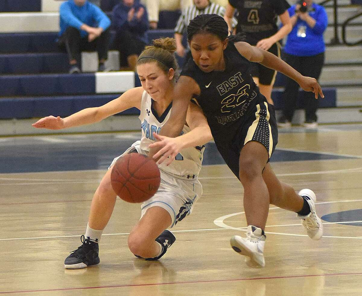 Wilton's Elizabeth Breslin, left, and East Hartford's Mychelle Barnes collide while tracking down a loose ball during the second half of Friday's game.