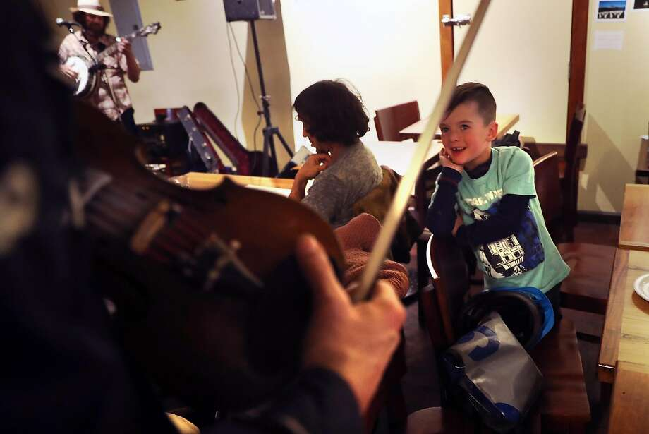 Donovan Epple, 6, laughs as Andy Lesko asks if he wants to play his fiddle during February's bluegrass jam at Atlas Cafe. Photo: Scott Strazzante, The Chronicle