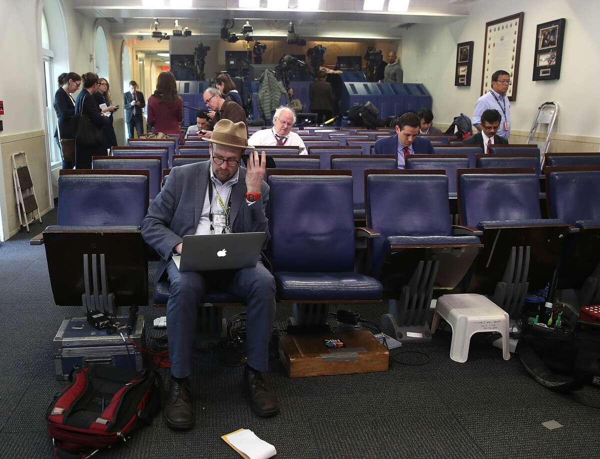 New York Times reporter, Glenn Thrush works in the Brady Briefing Room after being excluded from a press gaggle by White House Press Secretary Sean Spicer, on February 24, 2017 in Washington, DC. The New York Times, Los Angeles Times, CNN and Politico were also excluded from the off camera gaggle.