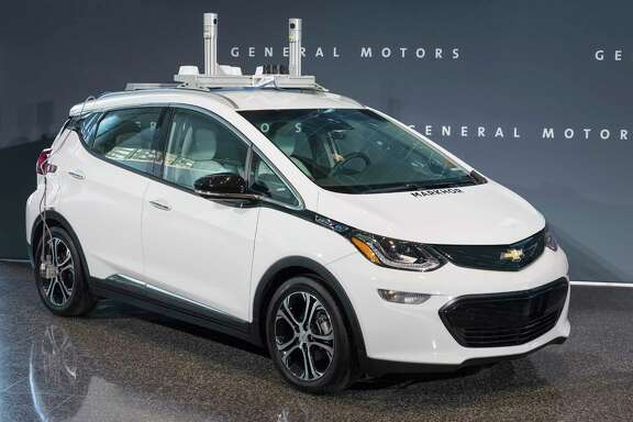 A General Motors self-driving car is displayed. GM is trying to persuade state lawmakers across the country to pass legislation that would clear the way for it to make self-driving cars publicly available while potentially limiting GM's rivals.