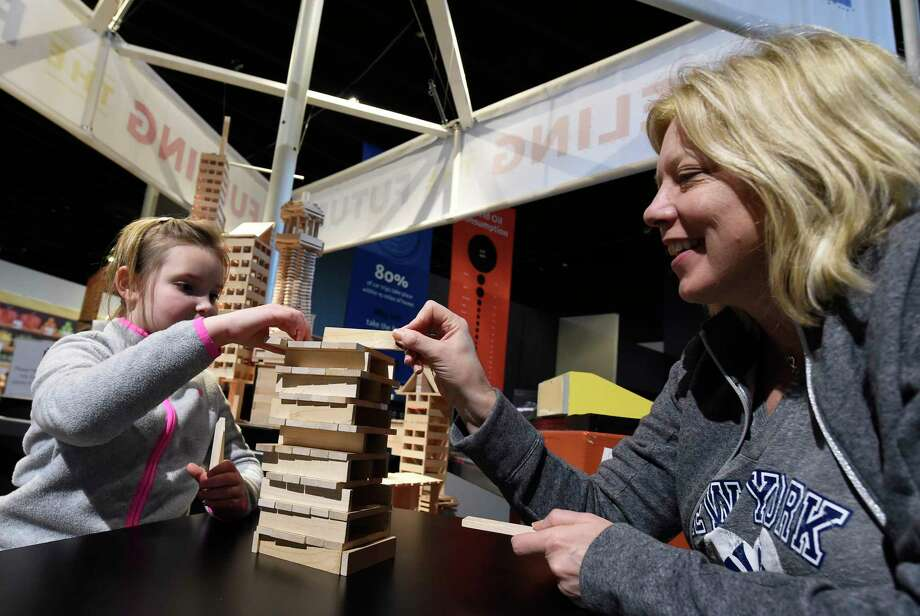 Skylar Theuvet 7, and her mom, Marguerite Teuvet of Rockaway Township, N.J. build a structure from wood slats at the MiSci museum Friday Feb. 24, 2017 in Schenectady, N.Y.  (Skip Dickstein/Times Union) Photo: SKIP DICKSTEIN / 20039793A