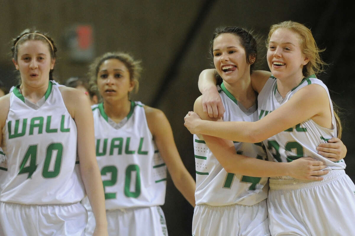 Wall basketball players celebrate a win against Bowie in the UIL Region I-AAA Girls Basketball semi final Friday, Feb. 24, 2017, at Chaparral Center. James Durbin/Reporter-Telegram