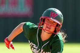 Skylar Stockton of The Woodlands heads toward third base after a two-run home run by Kelcy Leach off Liberty pitcher Sarah Lopez during the third inning of a high school softball game at The Woodlands Varsity Round Robin Invitational at The Woodlands High School Friday, Feb. 24, 2017, in The Woodlands.