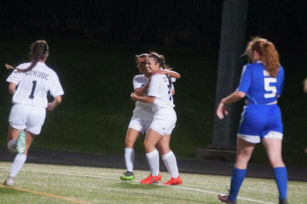 Conroe's Agustine Demagistris celebrates a goal against Oak Ridge on Friday.