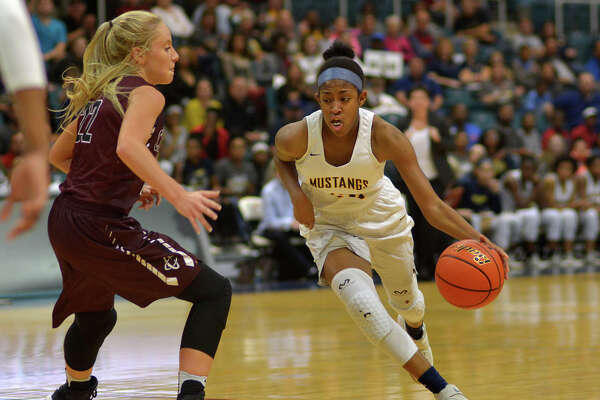 Cypress Ranch guard Shadiya Thomas, right, goes strong to the basket against Clear Creek guard Hannah Froeschl during the second quarter of Friday night's Region III-6A semifinal. Cy Ranch won 79-50.