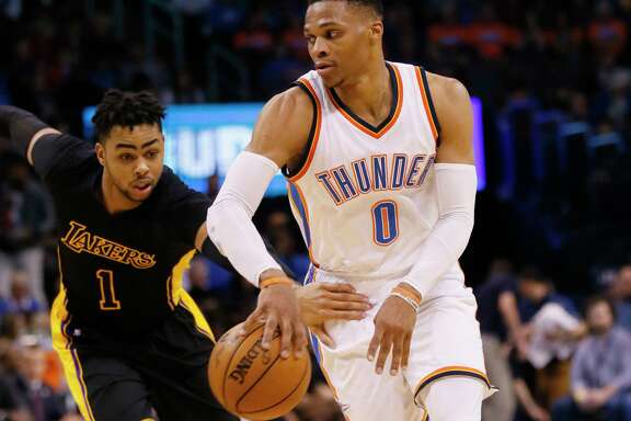D'Angelo Russell, left, and his Lakers teammates had a tough time keeping up with the Thunder's Russell Westbrook, who had 17 points, 18 rebounds and 17 assists for his 28th triple-double of the season.