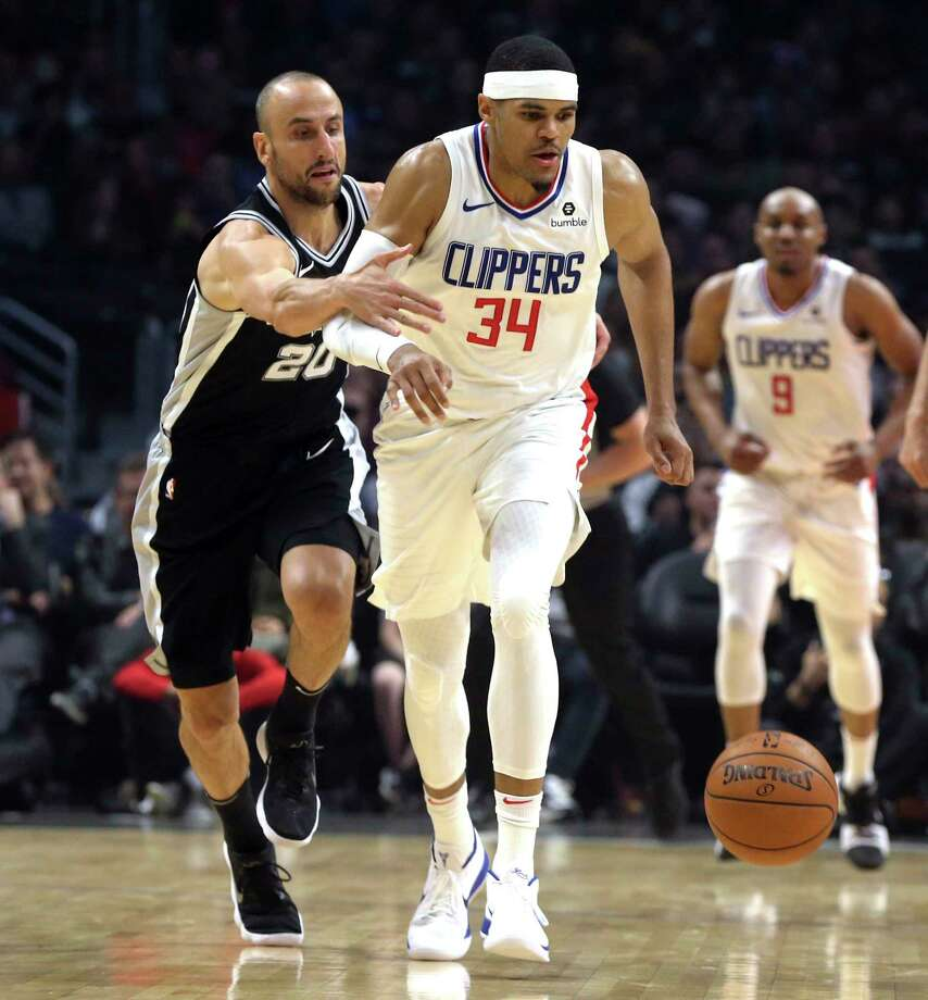 San Antonio Spurs guard Manu Ginobili (20) fouls Los Angeles Clippers forward Tobias Harris (34) during the first half of an NBA basketball game in Los Angeles on Tuesday, April 3, 2018. (AP Photo/Reed Saxon) Photo: Reed Saxon, Associated Press / Copyright 2018 The Associated Press. All rights reserved. This material may not be published, broadcast, rewritten or redistribu
