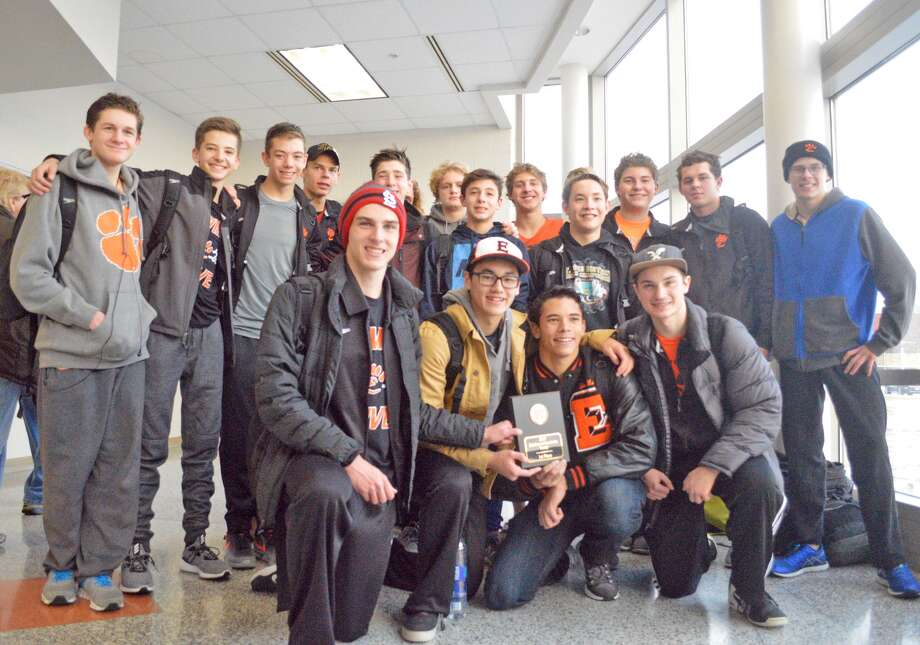 The Edwardsville boys' swimming team poses with the championship plaque from the Normal Community High School Iron Invite earlier in the regular season. It was the first time EHS had won the event.