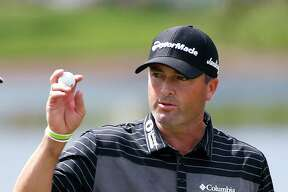 Ryan Palmer acknowledges the crowd as he finishes the second round of the Honda Classic golf tournament, Friday, Feb. 24, 2017, in Palm Beach Gardens, Fla. (AP Photo/Wilfredo Lee) ORG XMIT: FLWL105