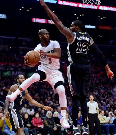 LOS ANGELES, CA - FEBRUARY 24:  Chris Paul #3 of the LA Clippers makes a pass around LaMarcus Aldridge #12 of the San Antonio Spurs during the first half at Staples Center on February 24, 2017 in Los Angeles, California.  NOTE TO USER: User expressly acknowledges and agrees that, by downloading and or using this photograph, User is consenting to the terms and conditions of the Getty Images License Agreement.  (Photo by Harry How/Getty Images) Photo: Harry How/Getty Images