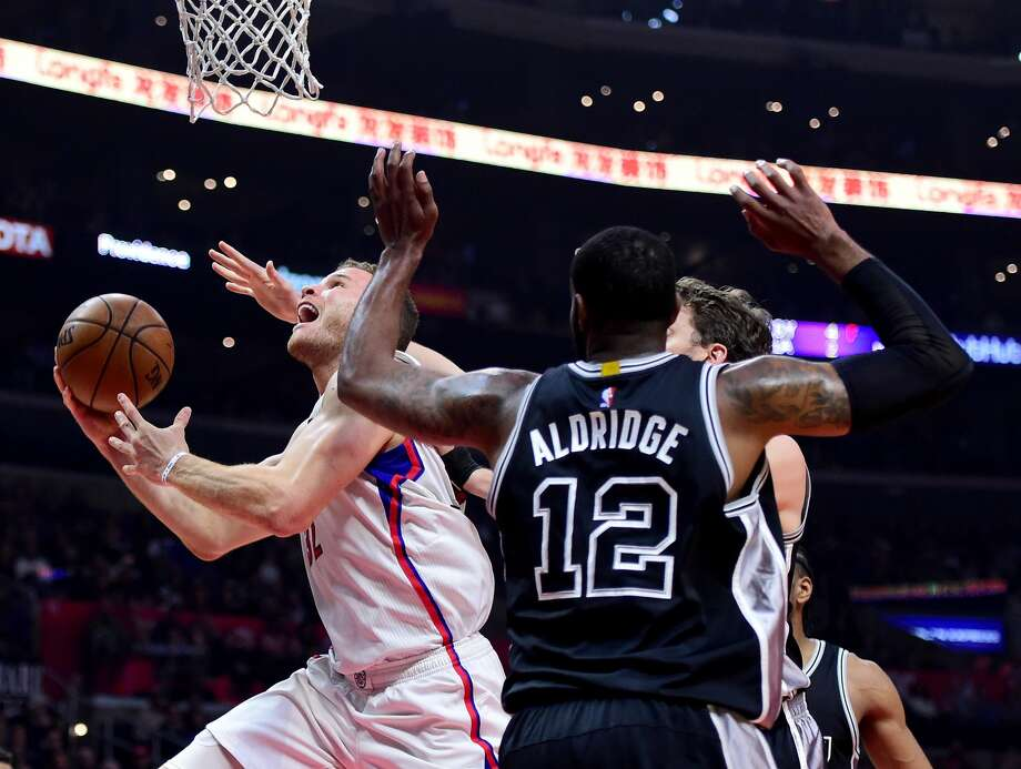 LOS ANGELES, CA - FEBRUARY 24:  Blake Griffin #32 of the LA Clippers scores on a layup past LaMarcus Aldridge #12 and Pau Gasol #16 of the San Antonio Spurs during the first half at Staples Center on February 24, 2017 in Los Angeles, California.  NOTE TO USER: User expressly acknowledges and agrees that, by downloading and or using this photograph, User is consenting to the terms and conditions of the Getty Images License Agreement.  (Photo by Harry How/Getty Images) Photo: Harry How/Getty Images