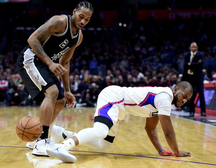 LOS ANGELES, CA - FEBRUARY 24:  Kawhi Leonard #2 of the San Antonio Spurs fouls Chris Paul #3 of the LA Clippers during the first half at Staples Center on February 24, 2017 in Los Angeles, California.  NOTE TO USER: User expressly acknowledges and agrees that, by downloading and or using this photograph, User is consenting to the terms and conditions of the Getty Images License Agreement.  (Photo by Harry How/Getty Images)