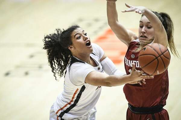 Kolbie Orum of Oregon State makes a move to the basket against Stanford's Alanna Smith as the Beavers' eke out a hard-fought victory over the Cardinal at Gill Coliseum in Corvallis.