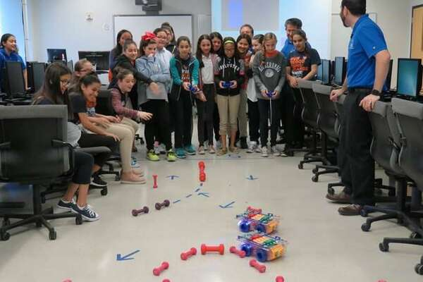 Sixth-grade students build Mars rover replica robots with engineers from Lackland Air Force Base during the 2017 STEM Alliance at TAMIU on Friday.