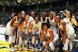The Cy Ranch Mustangs celebrate a dominant, 79-50 victory over Clear Creek in the regional semifinals Friday at the Merrell Center. Though the Mustangs fell behind 13-6 early, they rallied hard and the starters were once again able to sit for most of the second half of the contest.