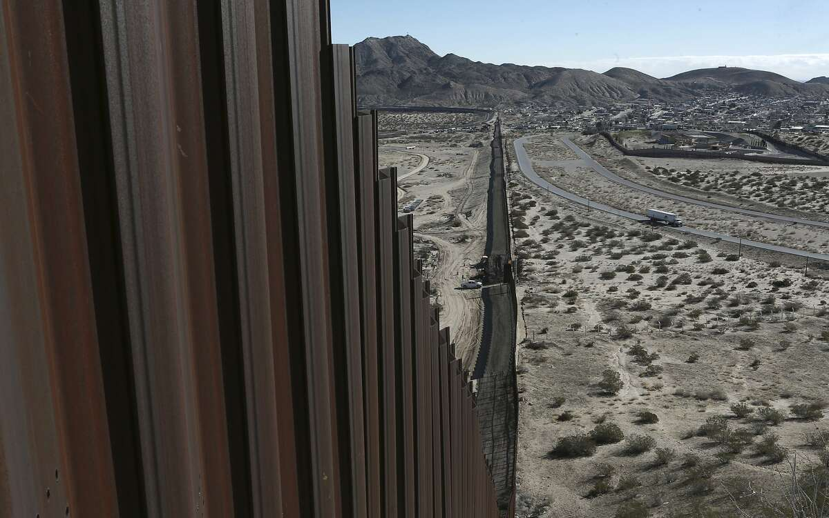 A truck drives near the Mexico-U.S. border fence separating the towns of Anapra, Mexico, and Sunland Park, New Mexico, in January.