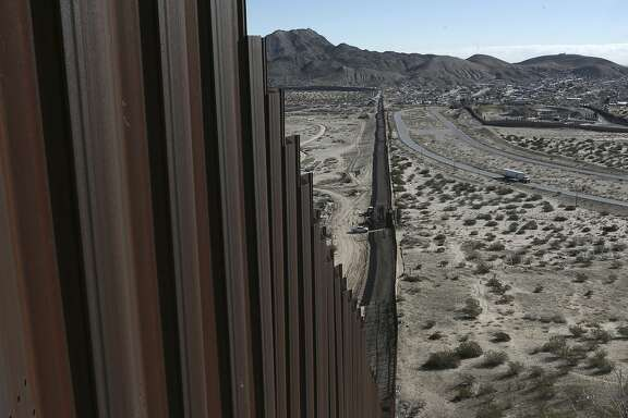 "FILE - In this Wednesday, Jan. 25, 2017 file photo, a truck drives near the Mexico-US border fence, on the Mexican side, separating the towns of Anapra, Mexico and Sunland Park, New Mexico.  U.S. Customs and Border Protection said Friday, Feb. 24, 2017 that it plans to start awarding contracts by mid-April for President Donald Trump's proposed border wall with Mexico, signaling that he is aggressively pursuing plans to erect ""a great wall"" along the 2,000-mile border. (AP Photo/Christian Torres, File)"