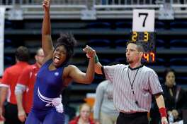 April Penn of Morton Ranch points toward the sky after defeating Courtney Garza of Katy in a Class 6A girls 185-pound championship semifinal bout during the UIL Wrestling State Championships Saturday, Feb. 25, 2017, in Cypress.