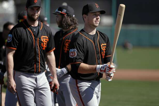 Catcher Buster Posey, 28 waits to take batting practice during the San Francisco Giants spring training workouts at Scottsdale Stadium on Wed. February  24, 2016, in Scottsdale, Arizona