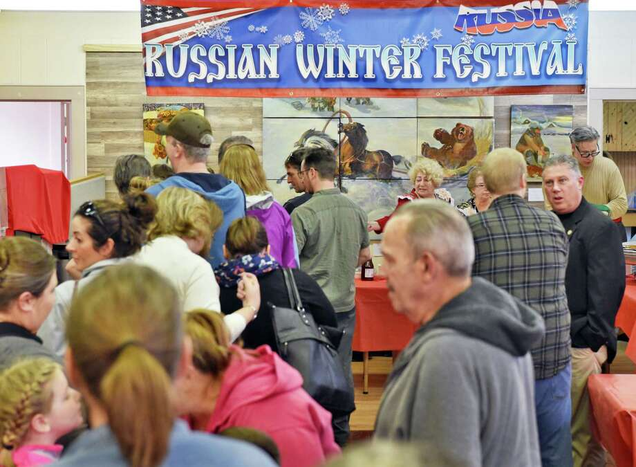 Festival goers queue up for traditional Russian food at the Russian Winter Festival at the New Russia Cultural Center Saturday Feb, 25, 2017 in Rensselaer, NY.  (John Carl D'Annibale / Times Union) Photo: John Carl D'Annibale / 20039798A