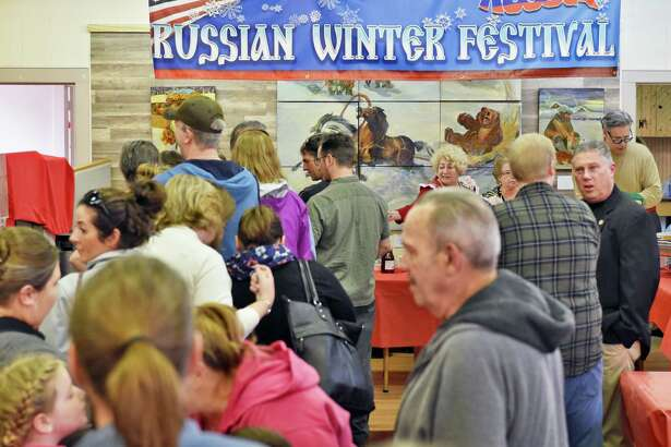 Festival goers queue up for traditional Russian food at the Russian Winter Festival at the New Russia Cultural Center Saturday Feb, 25, 2017 in Rensselaer, NY.  (John Carl D'Annibale / Times Union)