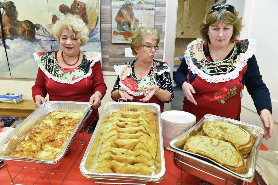 At the Russian Winter Festival in 2017, (l-r) Irina Smiznova, Rita Rutina and Irina Wheeler brought out traditional Russian fare: (l-r)  kotlety, pirozhki and blini at the New Russia Cultural Center  in Rensselaer, N.Y.  (John Carl D'Annibale / Times Union) Photo: John Carl D'Annibale / 20039798A