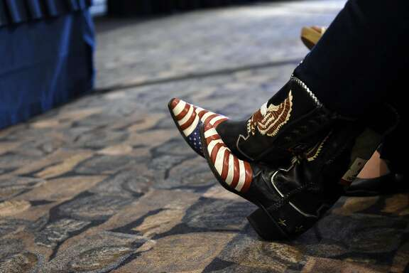 Mary Johnson of Paso Robles wears American flag and bald eagle adorned boots as she attends a Tea Party General Meeting at the California Republican Party's 2017 Organizing Convention in Sacramento, CA, on Saturday February 25, 2017.