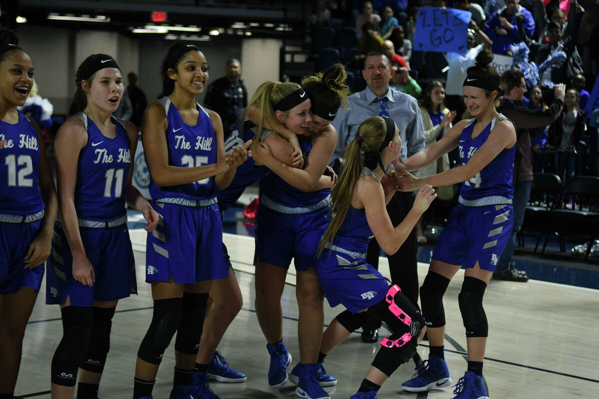 The Barbers Hill Lady Eagles celebrate their 55-43 win over Georgetown in the Region III-5A Girls Basketball Championship game at Delmar Fieldhouse in Houston on Saturday. (Photo by Jerry Baker/Freelance)
