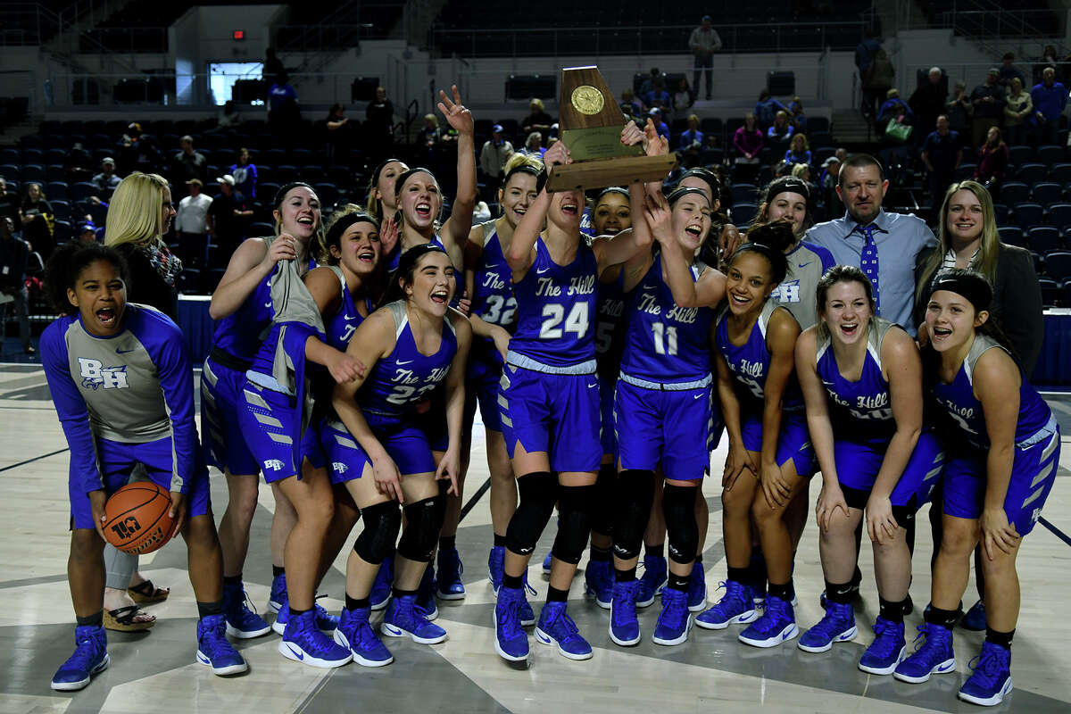 The Barbers Hill Lady Eagles hoist their trophy after their 55-43 win over Georgetown in the Region III-5A Girls Basketball Championship game at Delmar Fieldhouse in Houston on Saturday. (Photo by Jerry Baker/Freelance)