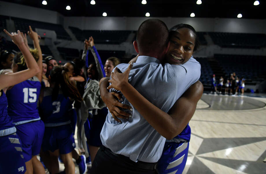 Barbers Hill junior post Charli Collier, right, shares a hug with Head Coach Tri Danley after the Lady Eagle's 55-43 win over Georgetown in the Region III-5A Girls Basketball Championship game at Delmar Fieldhouse in Houston on Saturday. (Photo by Jerry Baker/Freelance) Photo: Jerry Baker, For The Chronicle / Freelance
