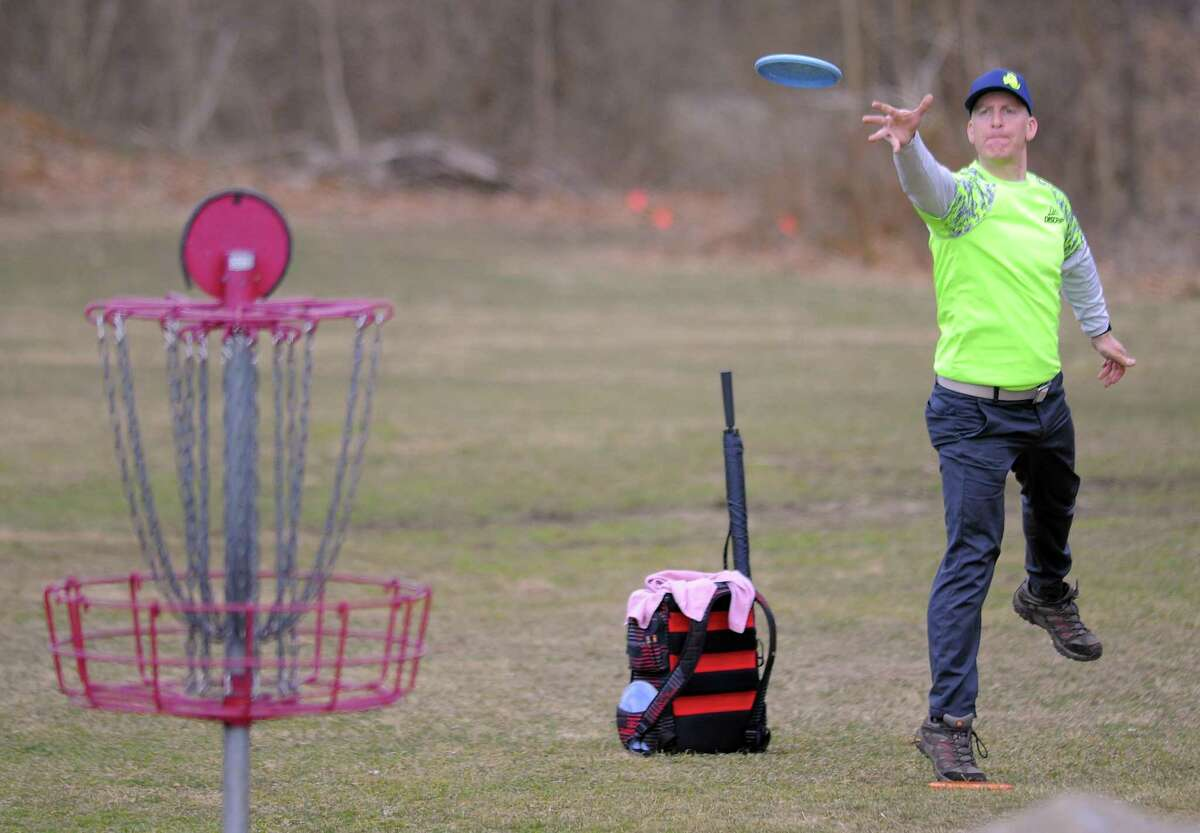 Professional Disc Golfer Adam Goodman of Fairfield, Conn. pitches to the first hole as he competes in the 2017 Cranbury Ice Bowl , a disc golf charity event at Norwalk's Cranbury Park on Feb. 25, 2017. A mix of professional and amateur disc golf players participated in the two round 18-hole tournament, raising over $2500.00 in cash/can food donations that will benefit the Norwalk food shelter. It's the disc golfers way of saying thanks to the city of Norwalk for all the support over years.
