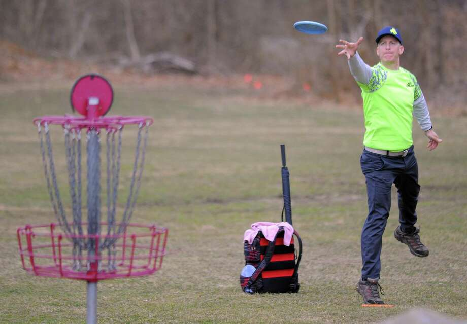 Professional Disc Golfer Adam Goodman of Fairfield, Conn. pitches to the first hole as he competes in the 2017 Cranbury Ice Bowl , a disc golf charity event at Norwalk's Cranbury Park on Feb. 25, 2017. A mix of professional and amateur disc golf players participated in the two round 18-hole tournament, raising over $2500.00 in cash/can food donations that will benefit the Norwalk food shelter. It's the disc golfers way of saying thanks to the city of Norwalk for all the support over years. Photo: Matthew Brown / Hearst Connecticut Media / Stamford Advocate