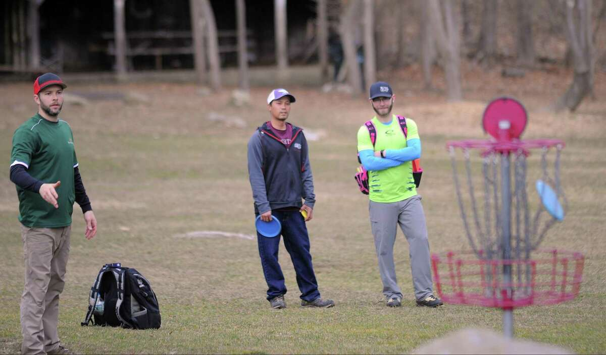 Professional Disc Golfer Jeff Cahill of Norwalk, at left, makes par at the first hole as he competes in the 2017 Cranbury Ice Bowl , a disc golf charity event at Norwalk's Cranbury Park on Feb. 25, 2017. A mix of professional and amateur disc golf players participated in the two round 18-hole tournament, raising over $2500.00 in cash/can food donations that will benefit the Norwalk food shelter. It's the disc golfers way of saying thanks to the city of Norwalk for all the support over years.