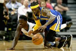 DENVER, CO - FEBRUARY 13: Johnny O'Bryant #9 of the Denver Nuggets and Briante Weber #2 of the Golden State Warriors fight for a loose ball at the Pepsi Center on February 13, 2017 in Denver, Colorado. NOTE TO USER: User expressly acknowledges and agrees that , by downloading and or using this photograph, User is consenting to the terms and conditions of the Getty Images License Agreement.  (Photo by Matthew Stockman/Getty Images)