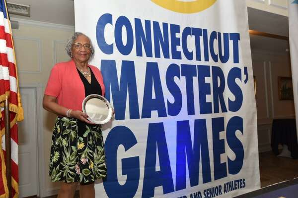 Norwalk's Mary Roman displays the silver plate she received Thursday night for being named the 2016 Connecticut Masters Games Athlete of the Year.