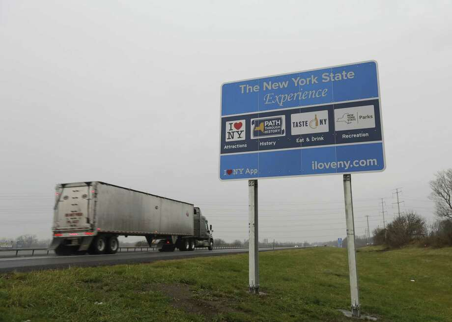 "A truck passes a sign for ""I Love New York"" and other state attractions on the New York State Thruway, Tuesday, Nov. 29, 2016, in Utica, N.Y. Officials with the Federal Highway Administration and the New York Department of Transportation will meet in December to discuss the removal of more than 500 iI Love NYi signs from the stateís roadways. FHA officials say the signs donít conform to federal standards and pose a dangerous distraction for motorists. (AP Photo/Mike Groll) ORG XMIT: NYMG102 ORG XMIT: MER2016112909554932 Photo: Mike Groll / Copyright 2016 The Associated Press. All rights reserved."