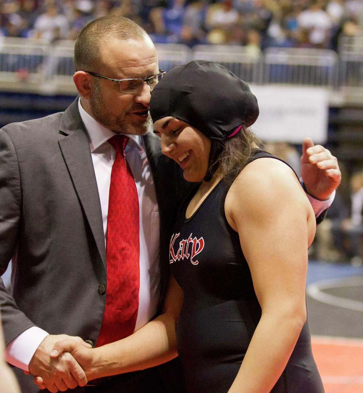 Courtney Garza of Katy smiles after defeating Ariana Mendoza of Comal Smithson Valley to win third place in the Class 6A girls 185-pound consolation final at the UIL Wrestling State Championships Saturday, Feb. 25, 2017, in Cypress.