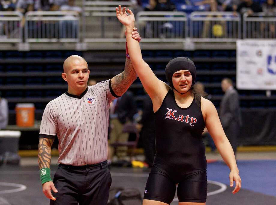 Courtney Garza of Katy defeated Ariana Mendoza of Comal Smithson Valley to win third place in the Class 6A girls 185-pound consolation final at the UIL Wrestling State Championships Saturday, Feb. 25, 2017, in Cypress. Photo: Jason Fochtman, Houston Chronicle / © 2017 Houston Chronicle