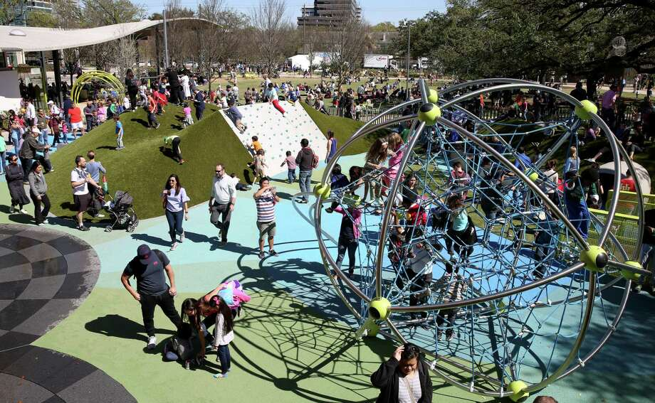 "The playground at Houston's newly reopened Levy Park in Upper Kirby includes a climbing wall and ""Cosmo,"" a 14-foot buckyball with a web of climbing cables inside. Photo: Yi-Chin Lee, Houston Chronicle / © 2017  Houston Chronicle"