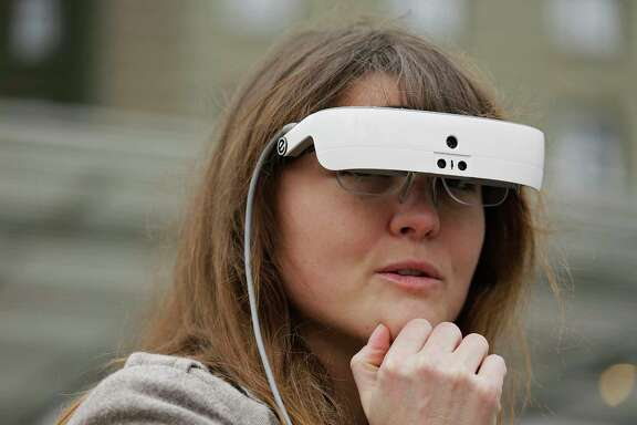 Yvonne Felix, who was diagnosed with Stargardt's disease after being hit by a car at age 7, wears eSight electronic glasses in San Francisco.