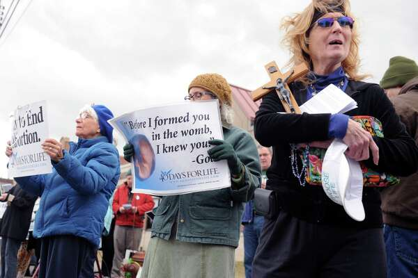 Beth Lynch (right), president of the Schenectady County Right To Life group, protests outside of a Planned Parenthood in Schenectady, N.Y. on Feb. 25, 2017. Lynch was one of about 40 people gathered as part of a month-long movement to dissuade pregnant mothers to have abortions. (Robert Downen/Times Union)