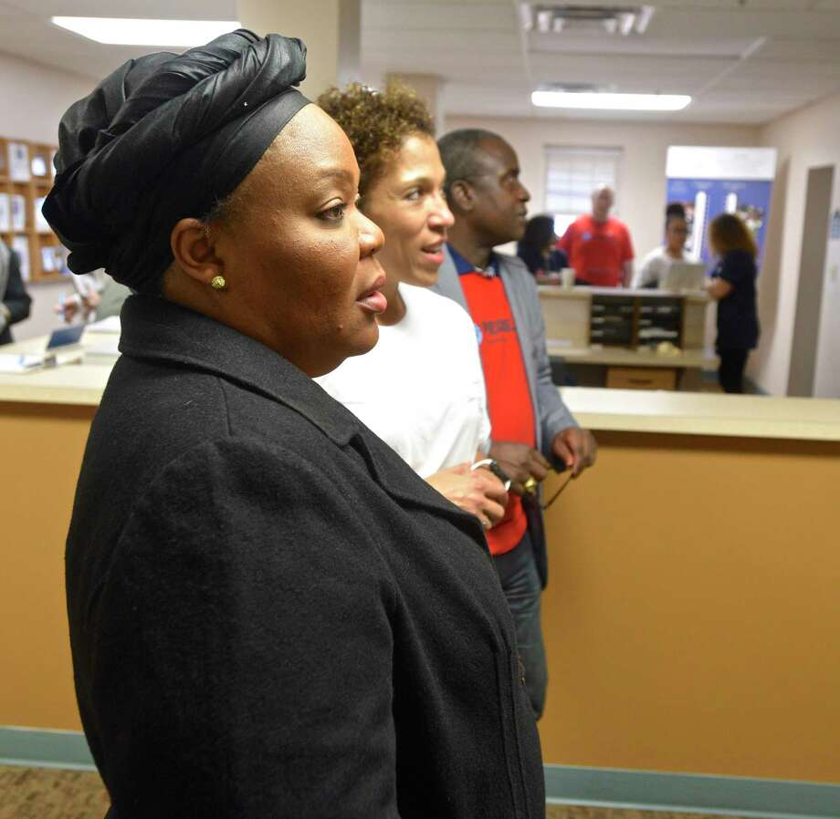 Leymah Gbowee, awarded the 2011 Nobel Peace Prize, looks over the murals in the Jericho Partnership lobby with Jericho President Carrie Amos, right, during a tour of the Danbury facility. Gobwee was visiting Jericho during the 2017 PeaceJam Conference. Saturday, February 25, 2017, in Danbury, Conn. Photo: H John Voorhees III, Hearst Connecticut Media / The News-Times