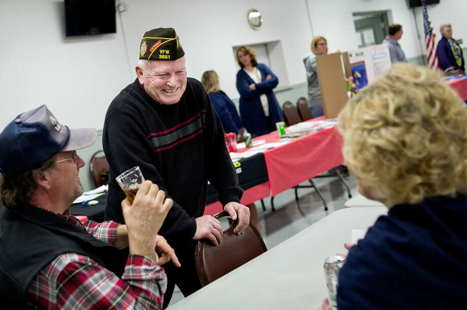 Post Commander Steve Tracy, center, talks with Garry Fritz, left, and Debbie Purcell during an open house on Saturday at the Veterans of Foreign Wars Chemical City Post #3651 in Midland. Completed renovations to the building include new lighting, paint, floors inside and a new look outside, to name a few. Photo: NICK KING   Nking@mdn.net