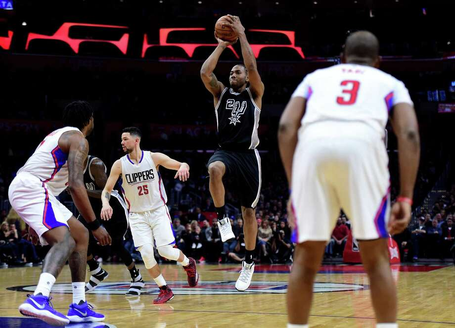 LOS ANGELES, CA - FEBRUARY 24:  Kawhi Leonard #2 of the San Antonio Spurs shoots during a 105-97 Spurs win over the LA Clippers at Staples Center on February 24, 2017 in Los Angeles, California.  NOTE TO USER: User expressly acknowledges and agrees that, by downloading and or using this photograph, User is consenting to the terms and conditions of the Getty Images License Agreement.  (Photo by Harry How/Getty Images) Photo: Harry How, Staff / Getty Images / 2017 Getty Images