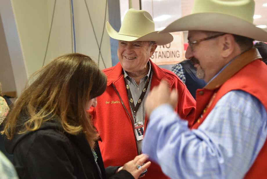 San Antonio Stock Show and Rodeo Chairman of the Board Joe Soules, (center) talks with attendee's to the annual steer auction Saturday morning. Photo: Robin Jerstad, Freelance / San Antonio Express News / ROBERT JERSTAD